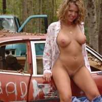 Outside Standing By Automobiles In The Woods Nude Car Junk Yard