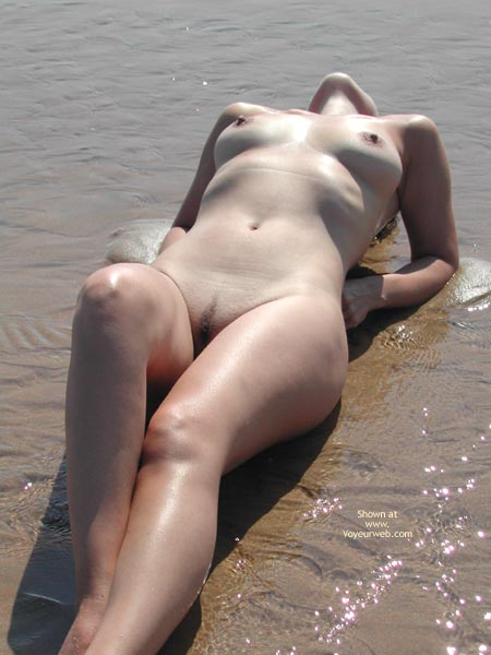 Pic #1 - Lying Naked On Beach In The Water - Landing Strip , Lying Naked On Beach In The Water, Medium Sized Tits, Landing Strip, Arched Back, Fully Nude