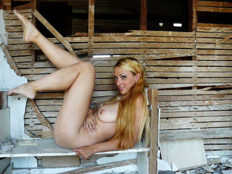 Pic #1 - Hottie On Rubble - Blonde Hair, Large Breasts, Long Hair, Long Legs, Looking At The Camera, Naked Girl, Nude Amateur , Sexy Babe, Nude Outside, Reclined With Legs Up, Arched Eyebrows, Wicked Smile, Legs Up, Very Long Strawberry Blond Hair., Posing Outdoors