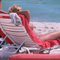 Topless In A Lounge Chair On The Beach - Spread Legs, Topless Beach, Topless, Beach Tits, Beach Voyeur, Naked Girl, Nude Amateur