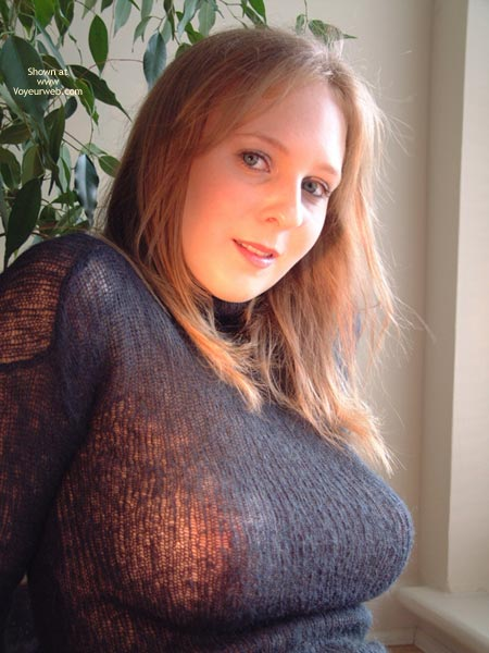 Pic #1 - Thin Top Showing Her Big Tits - Big Tits, See Through , Sitting Leaning Back, Sitting Blond - Big Breasts, Violet Sweater, Stretched By Generous Tits, Sitting In Sunlight At Window, Stretch Sweater, Barely Holding Them Together, Dark Sweater, Full Breasts, Big Boobs, Pretty Face, Large Natural Hangers