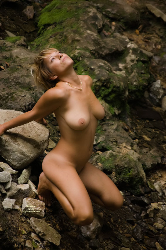 margotiti? sexy wife nude with nature squatting on rocks