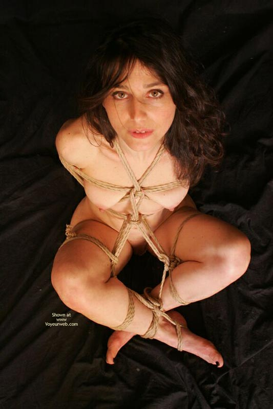 Pic #1 - Arms Behind In Rope Bondage - Black Hair, Bondage, Nude Amateur , All Tied Up!, Sitting With Legs Crossed Above Ankles, Green Eyes, Sitting Nude Bound, Looking Up At Viewer, All Knoted Together, Tied Up For Transport