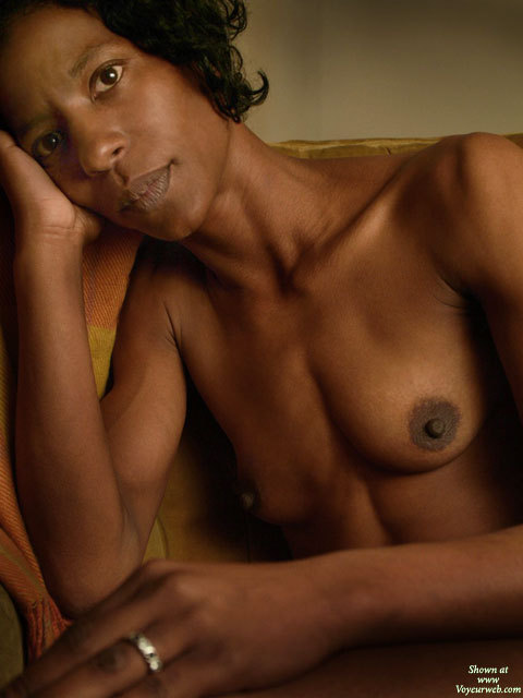 Pic #1 - Beautiful Mature Black Woman - Black Hair, Topless , Classy Pose, Topless Black Portrait With Eye Contact, Slim Body, Long Neck, Hard Bodies, Topless Indoor Sitting, Full Lips, Brown Eyes