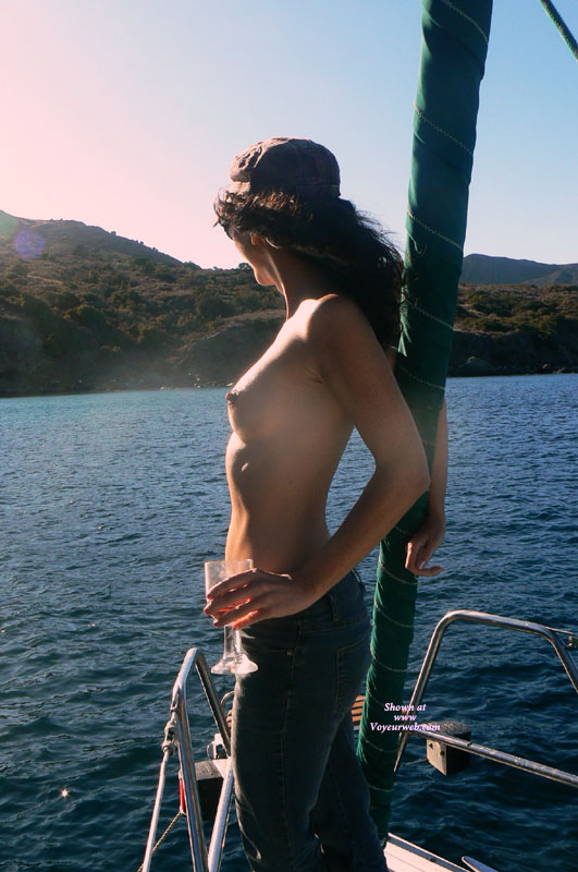 Pic #1 - Topless In Jeans On The Foredeck - Brown Hair, Long Hair, Small Breasts, Topless , Sexy Girl, The Skippers Girl, Standing On Boat Bow, Standing Sideways, Sideways Nipples, Standing Topless, Side Profile, Topless Girl Enjoying The View Over The Water, Hard Nipple, Erect Tits And Blue Jeans, Boat, Nipples In Sea Breeze, Island Teasing, Topless Girl