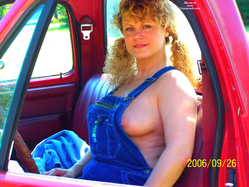 Pic #1 - MILF In A Pickup Truck - Blonde Hair, Erect Nipples, Milf , Country Tits, Long Erected Nipples, Blonde Curly Hair, Side Boob, Vehicle Pose, Sitting In Truck, Farmer Girl Nipple Peak, Country Girl, Peek-a-boo Nipple, Denium Overalls, Peeking Nipple, Pigtails In A Pickup, Blue Denim Overalls