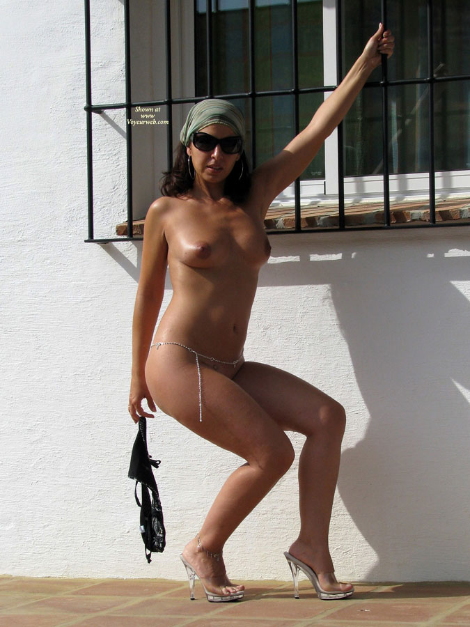 Pic #1 - Nude With Sunglasses - Brunette Hair, Heels, Nude Outdoors, Sunglasses, Naked Girl, Nude Amateur , Naked Outside, Tanned All Over, Silver Waist Chain, Big Sunglasses, Standing In High Heels, Brunette Nude, Black Sunglasses, Posing In Front Of White Wall, Dark Nipples