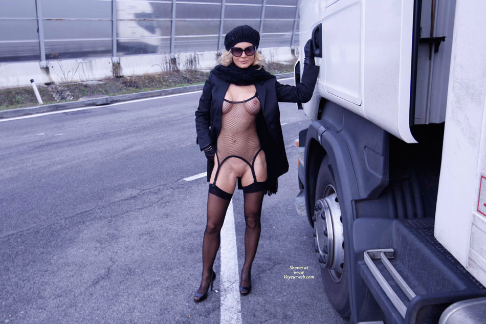 Truckstop Fishnet And Bare Pussy - Blonde Hair, Heels, Shaved Pussy, Stockings , Blonde Shaved Pussy, Dressed To Kill, High Heels With Visible Toes, Smiling At Camera, Black Sheer Stockings, Black Hat, Tits And Trucks, Trucker's Fantasy, Black Fishnet Body Suit, Flasher Coat
