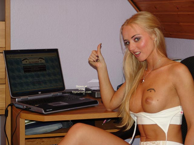 Pic #1 - Topless Blonde Works At  Laptop , Topless Blonde Works At  Laptop, Dark Eyed Blonde, Voyeurweb Label, Top Peeled Open