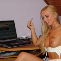 Topless Blonde Works At  Laptop
