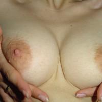 Squeeze Tits - Erect Nipples