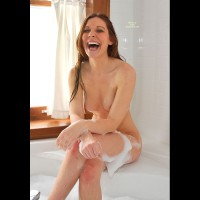 Colleen: brunette nude laughing wet skin