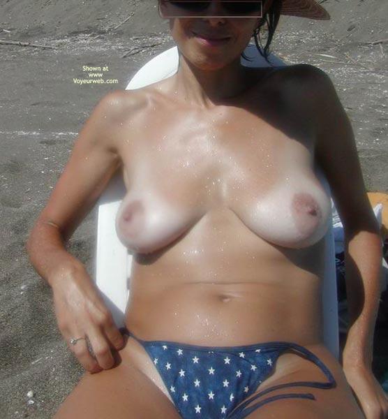 Pic #1 - Loose Thong - Erect Nipples, Tan Lines, Thong, Topless Beach , Loose Thong, Beach Babe, Large Areols, Erect Nipples, Topless On Beach, Tanlines