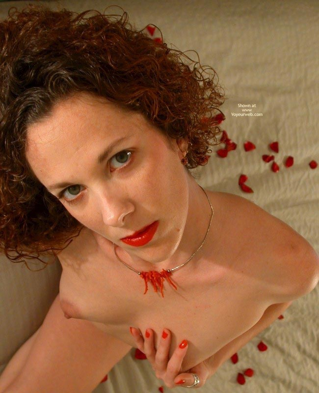 Pic #1 - Posed Indoors - Eye Contact, Green Eyes, Pale Skin , Posed Indoors, Lipstick, Rose Petals, Red Lips And Nails, Eye Contact, Curly Auburn Hair, Green Eyes, Pale Skin