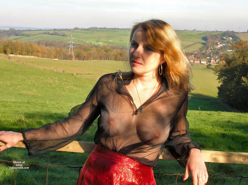Pic #1 - Mature Woman With See Through Blouse - Big Tits, Blonde Hair, Long Hair , Red Vinyl Skirt, See Through Top, Natural Breasts, Standing At The Fence, Sheer Top, Black Sheer Shirt, Long Strawberry Blonde Hair, Beautiful Lady, Beautiful Landscape, Hoop Earrings, Natural Breast, Posing Against Fence, Posing Outside, Seethru, Necklace, Tits Under Clothing, Blond, See Through