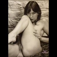 golden100: nude girl against a stone wall
