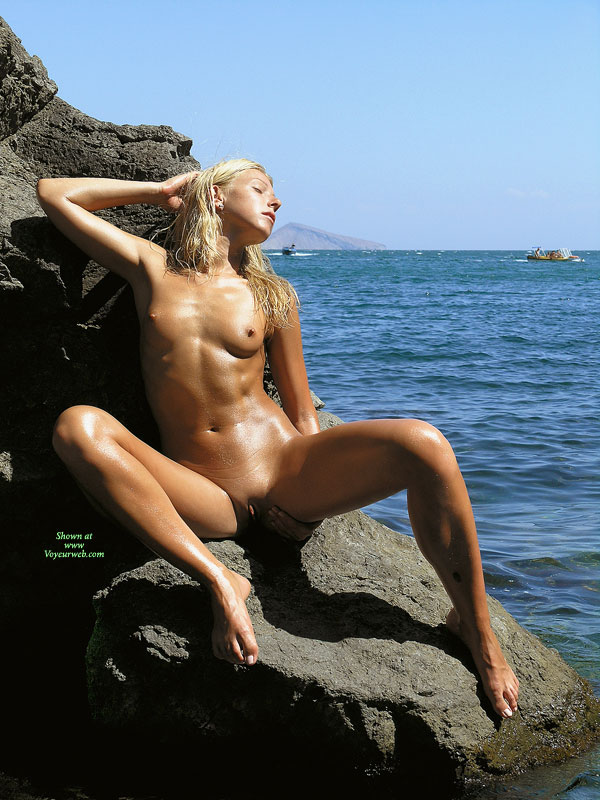 Pic #1 - Nude Slim Blond Girl Sitting On Basalt Outcrop - Blonde Hair, Hard Nipple, Long Hair, Small Tits, Naked Girl, Nude Amateur , Clean Shaven, Sitting On A Rock, Slim Body, Long Narrow Feet With Long Toes, Prominent Pussy Lips, Sunning On A Rock