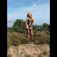 Sexy Babe Outdoors In Bondage Suit