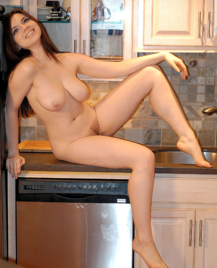 Naked chick on kitchen counter, black chatline porn