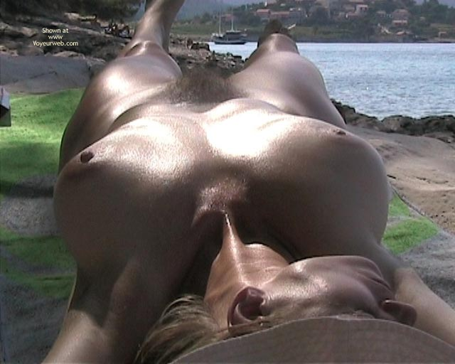 Nude Sunbathing Eposed In Public Oiled And Tan Big Tits The Sun