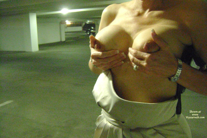 Heres my Wife flashing her Big nipples in public