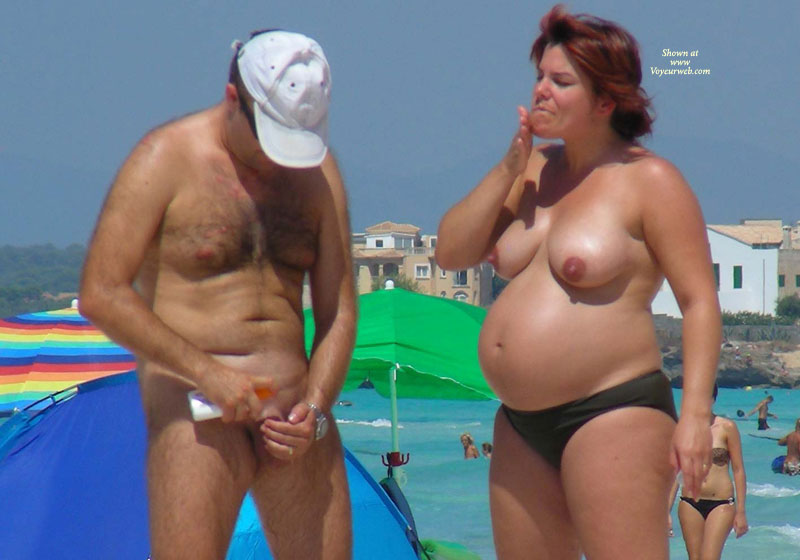 Pregnant woman at nude beach