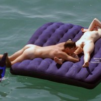 Nude resting on air-mattresses