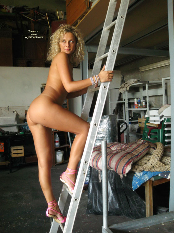 Pic #1 - Nude Girl Climbing To Garage Loft - Blonde Hair, Heels, Milf, Naked Girl, Nude Amateur , Posing On A Ladder, Naked Climber, Bare Ass, Naked On A Ladder, Sexy Shoes, With High Heels On A Ladder, Eyes Open, Totally Naked On A Ladder