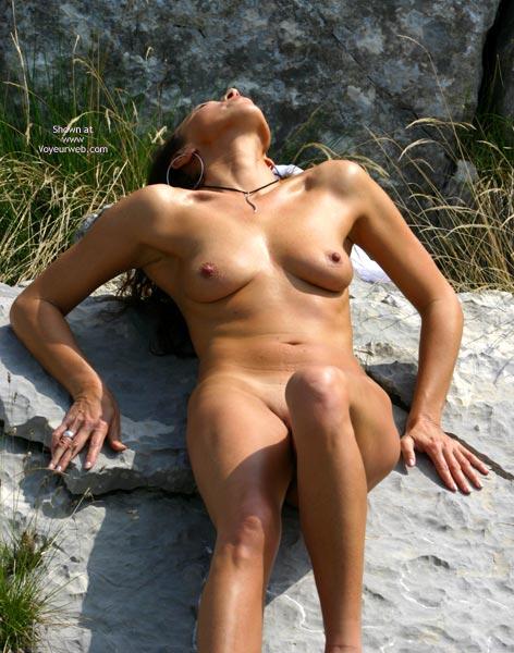Pic #1 - Outdoor Nude - Artistic Nude, Big Nipples, Nude Outdoors, Small Breasts , Outdoor Nude, Artistic Pose, Real Breast, Small Breast, Big Nipples, Tan On The Rocks, Head Back, Pushing Down On Hands, Sunlight Reflecting Of Skin, Large Hoop Earings