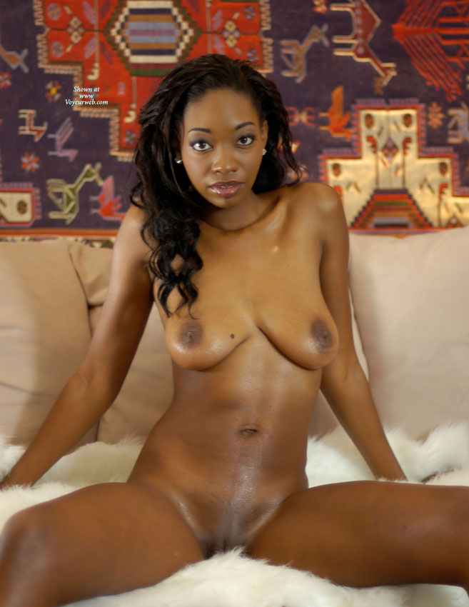 Naked african woman sitting