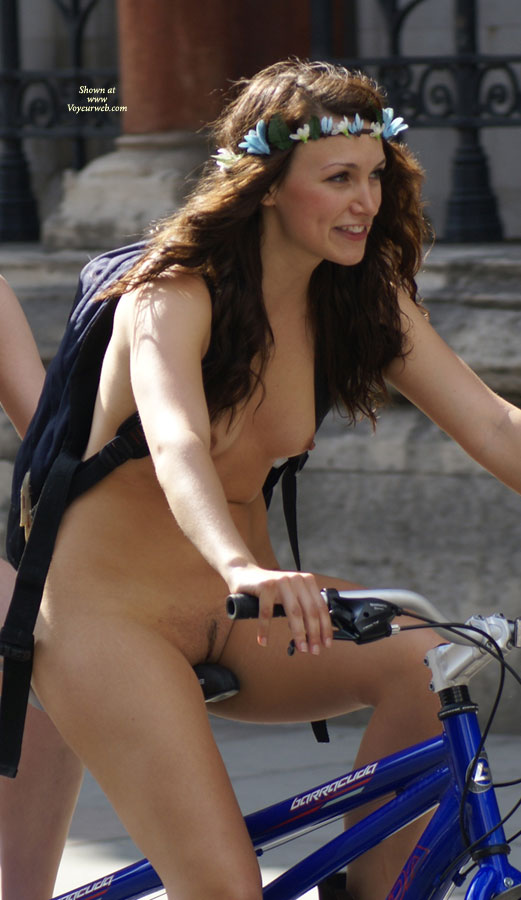 Girl nude on bicycle