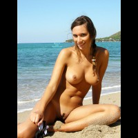 Gattina: naked brown haired girl with trimmed pussy on the beach