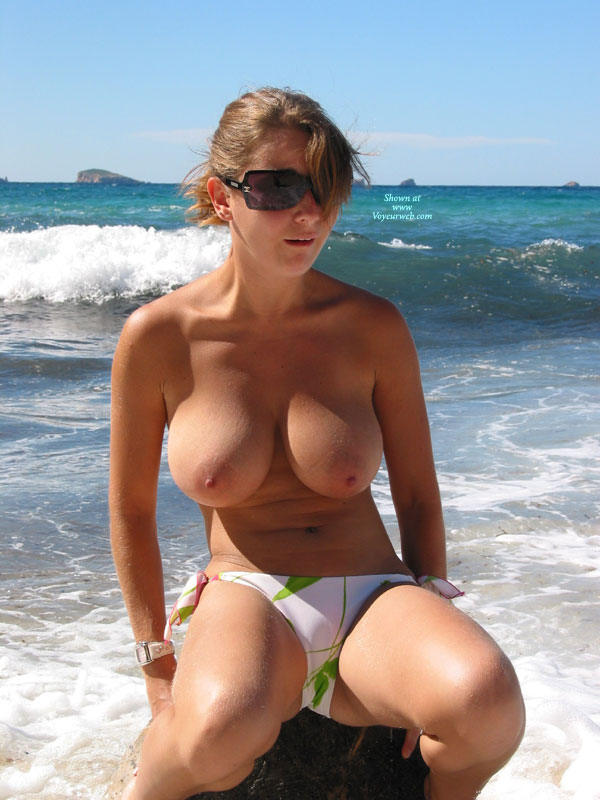 Big boobs topless beach