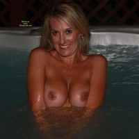 Misty: smiling in hottub flashing boobs