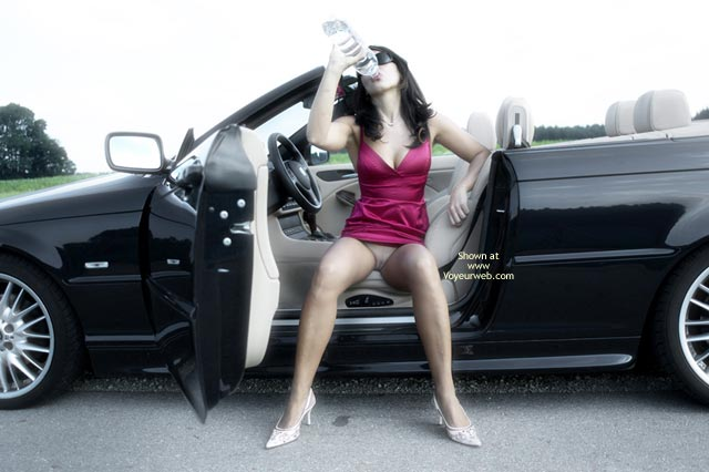 Pic #1 - Pantyless Sexy Girl In Car - Heels, Spread Legs , Pink Dress, Dress Pulled Up Showing Smooth Mons, Drinking A Bottle, Wearing Shades, Black Convertable, White High Heels, Brunett In Car, Sitting In A Car, Drinking Water, Bottled Water, Pantyless In Car, Red Dress, Smooth Coochie