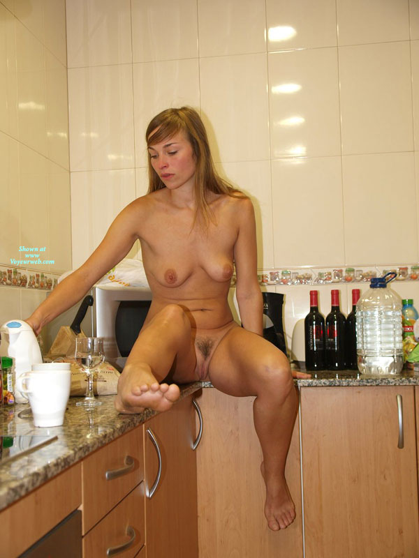 Milf bottomless in the kitchen nude