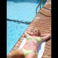 Mature Grandmother By The Pool