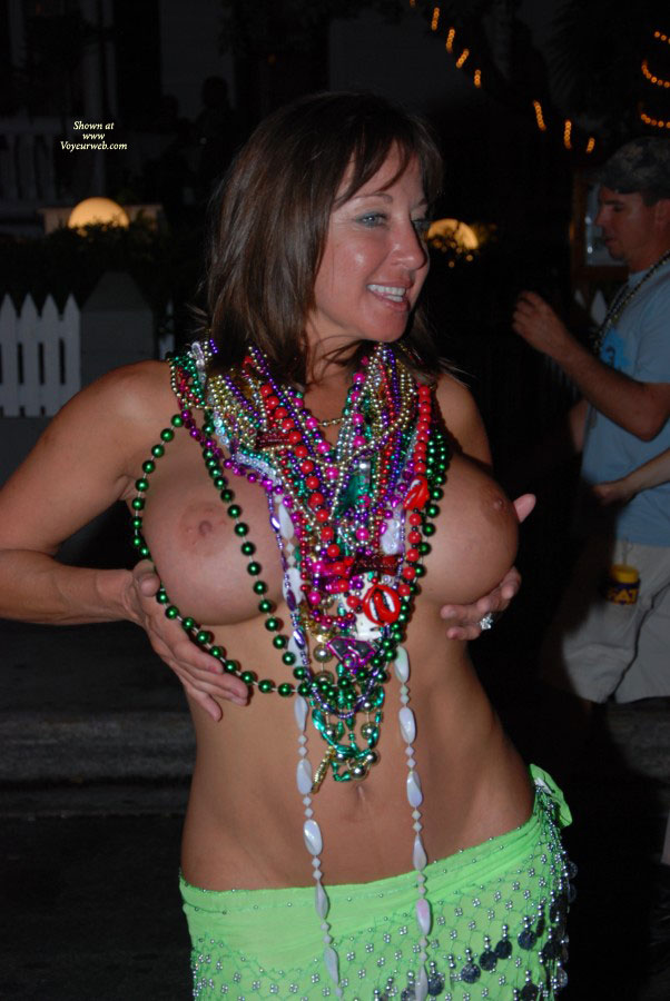 Topless Fantasy Fest - Big Tits, Firm Tits, Hard Nipple, Topless , Big Round Tits, In Green Sarong, Decorated With Beads And Rhinestones, Mardi Gras Beads, Tits Fantasy Fest Key West, Dancing In A Party, Hard Perky Nipples