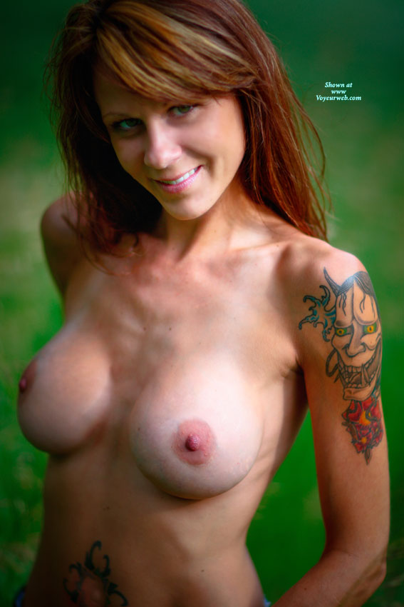 Pic #1 - Tits And Tats - Long Hair, Red Hair, Topless , Attractive Smile, Colorful Tatoos, Smiling At Camera, Topless Friend, Tattoo On Arm, Arm Tattoo, Topless Redhead, Long Red Hair, Fetching Smile