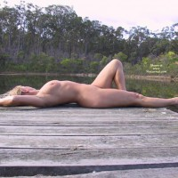 Nude Reclining On Dock - Nude Outdoors, Side View