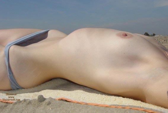 Pic #1 - Topless Beach - Close Up, Erect Nipples, Laying Down, Topless Beach , Topless Beach, Blue Bikini Bottom, Laying Down, Erect Nipples, Peeking Out, Small Tities, Beach Close-up, Nude Sunbathing, Streching Out