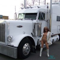 Big White Truck , It's Been Quite A While Since We Last Posted Here.  We Were Driving Around Last Weekend Looking For Some Good Photo Sites And Came Across This Truck.  Since It Matched Monique's Boots, We Stopped And Took Some Shots.  There Were Some Guys Unloading Another Truck Right Next Door.  They Didn't Notice Us Until Monique Was Completely Naked.