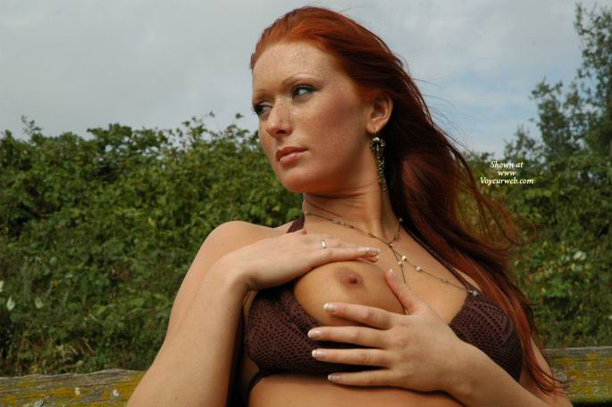 Pic #1 - Flashing One Tit - Bra, Redhead , Flashing One Tit, Ginger, Red Haired  Freckled, Hands Atop Single Breast, Knit Bra, Exposing Boob, Looking Away, Red Head