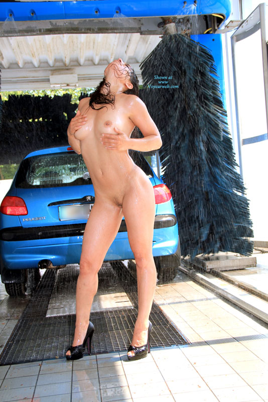 Nude while washing car