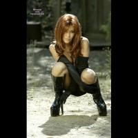 Woman In High Heel Black Boots