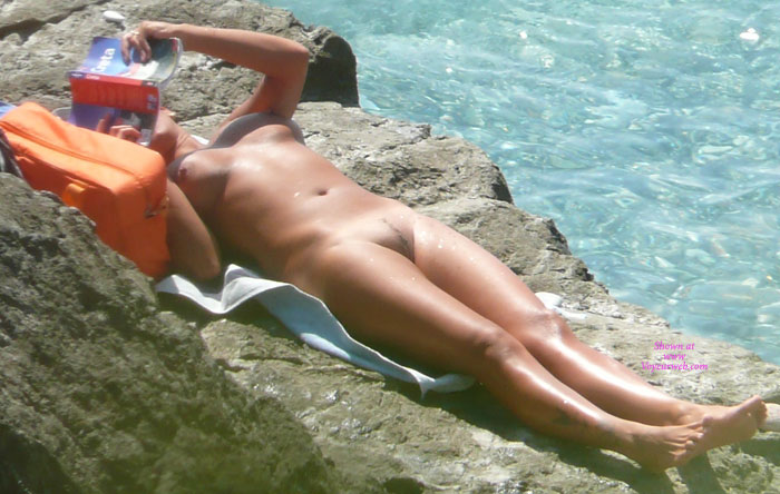 Nude sun tanning girls expose themselves to a beach spy cam 4