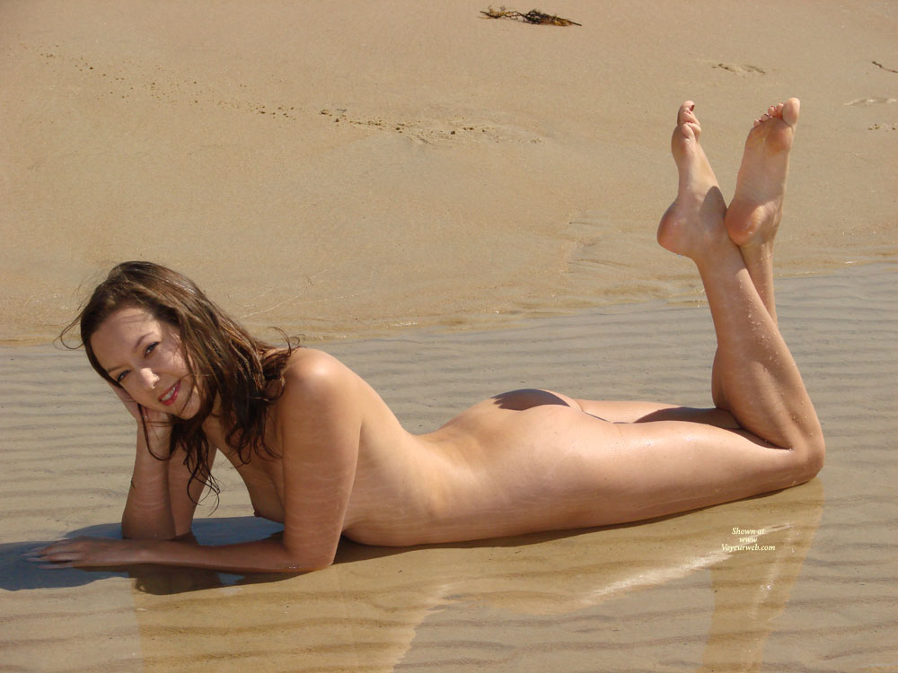 Sexy Nude Bunette Lying On Beach