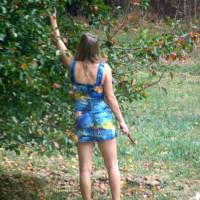 Hot Milf In The Yard In A Short Dress
