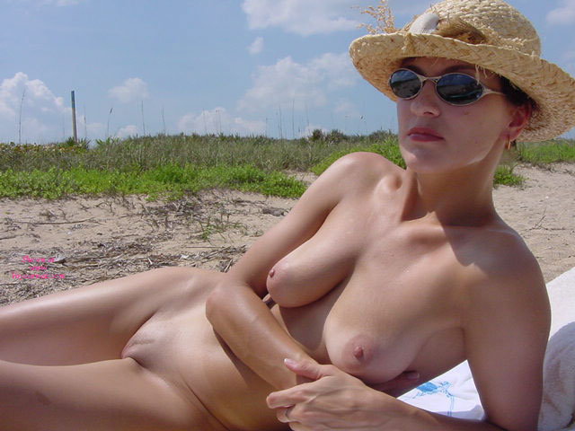 Naked wife tanning nude beach