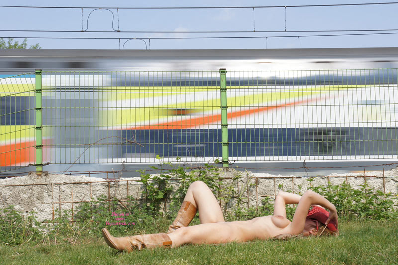 tourist love this train ride, reclining by train, laying on the grass, naked ...